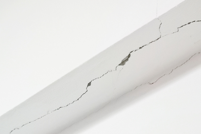 Cracks on walls and beams of plaster walls in a home