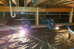 Water damage crawl space with blowers to dry it out